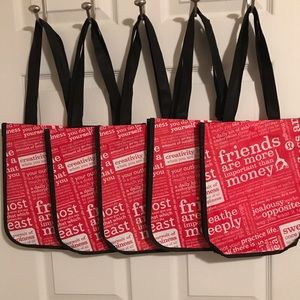 5 small red Lululemon shopping bags bundle